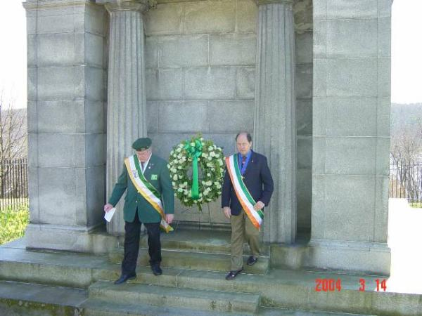 Bob Strutton and Jim Fitzgerald present wreath at the Dooley mausoleum