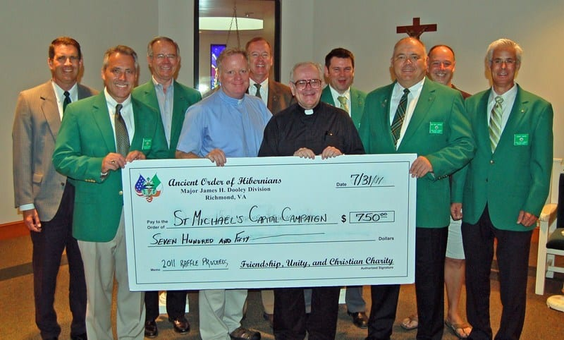 Mike Canning, Mitch Irvine, Dick Tucker, Fr. Jim Arsenault (St. Michael's Vicar and AOH Member), Bill Casey, Fr. Dan Brady (St. Michael's Pastor and AOH Member), Tim McDonnell (Raffle Co-Chair), Daniel Caffrey, Matt Brokaw and Doug Gavin. Missing Chad Costello (Raffle Co-Chair).